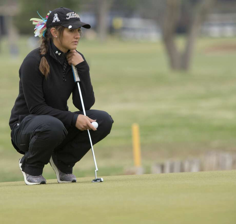 Andrews' Rachel Huffman looks at her line to putt 04/09/18 during District 4-4A golf at Ranchland Hills Golf Club. Tim Fischer/Reporter-Telegram Photo: Tim Fischer/Midland Reporter-Telegram