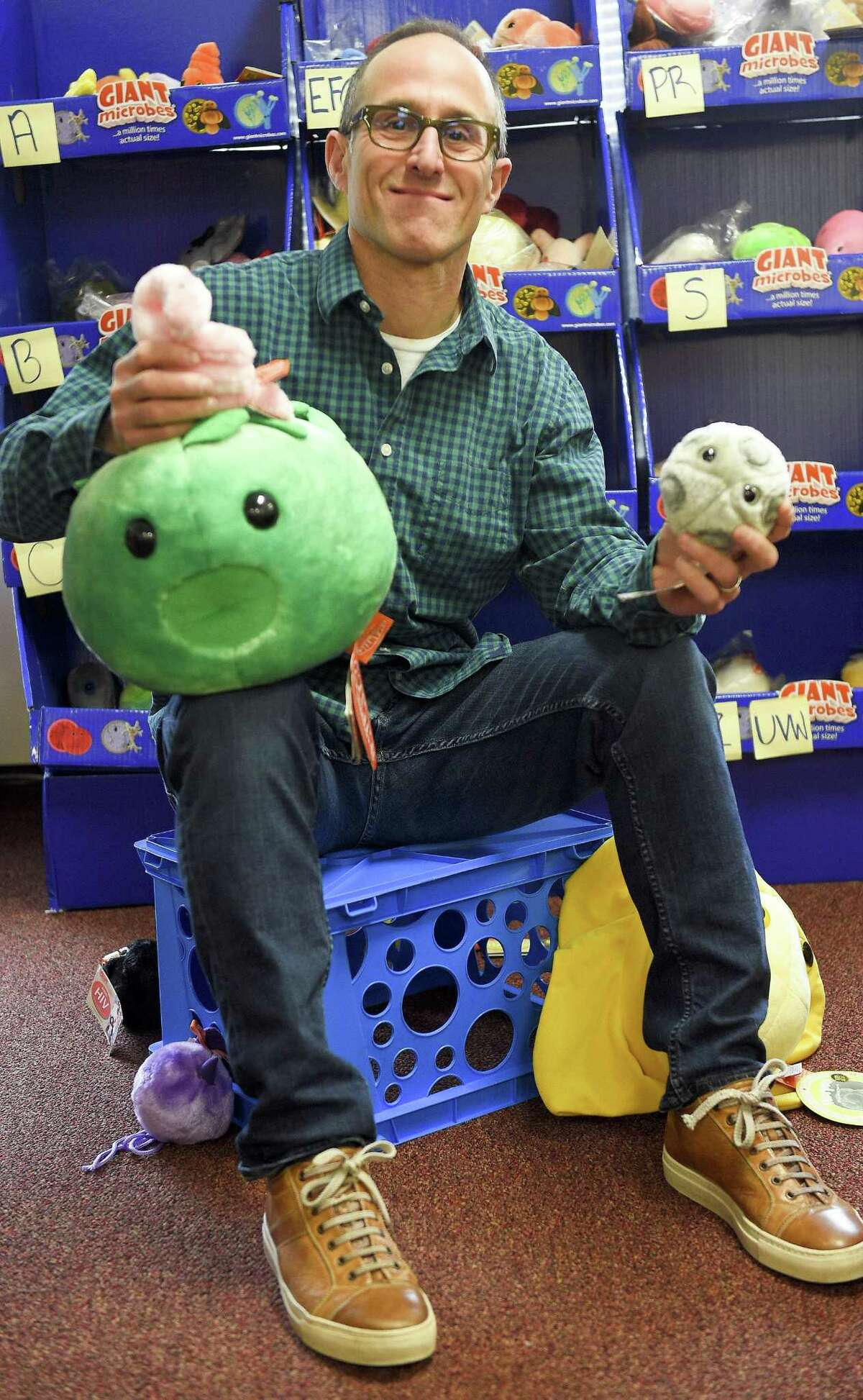 Andrew Klein, CEO of Giant Microbes, a Stamford-based toymaker is photographed on April 6, 2018 in Stamford, Connecticut. Klein's company recently released plush dolls depicting sexually transmitted diseases, such as Chlamydia and Herpes, along with eight other commonly known STD's, as part of the STD awareness month campaign.
