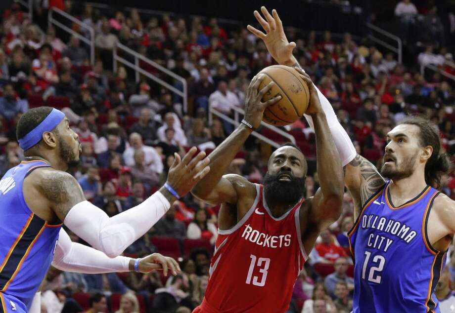Houston Rockets guard James Harden (13) drives for a shot between Oklahoma City Thunder forward Carmelo Anthony, left, and center Steven Adams (12) during the second half of an NBA basketball game Saturday, April 7, 2018, in Houston. (AP Photo/Michael Wyke) Photo: Michael Wyke, FRE / Associated Press / © Associated Press 2018