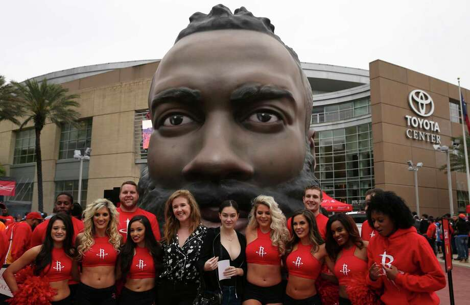 The Harden head was a very popular spot for fan photos and selfies. Here, Rockets general manager Daryl Morey's daughter, Karen (fourth from left, front row), also took a photograph with the Harden head and members of the Power Dancers squad. Photo: Yi-Chin Lee / © 2018 Houston Chronicle