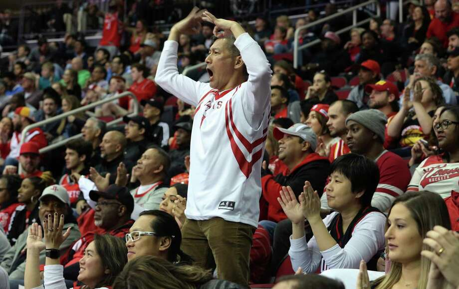 Rockets fan Michael Yong stands out from the crowd as he gets excited to celebrate Chris Paul's 3-pointer during the first quarter. Photo: Yi-Chin Lee / © 2018 Houston Chronicle