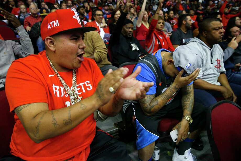 David Gonzalez, left, teases his little brother, Randy Gonzalez, as the Rockets score. Randy, 30, said he did not become a Thunder fan until he served time in a federal prison in El Reno, Okla. Randy could only follow the Thunder games via radio instead of on TV. For four years in the prison, he said he thought Kevin Durant and Russell Westbrook were white and he was shocked to find out that they are black after he was released. Photo: Yi-Chin Lee / © 2018 Houston Chronicle