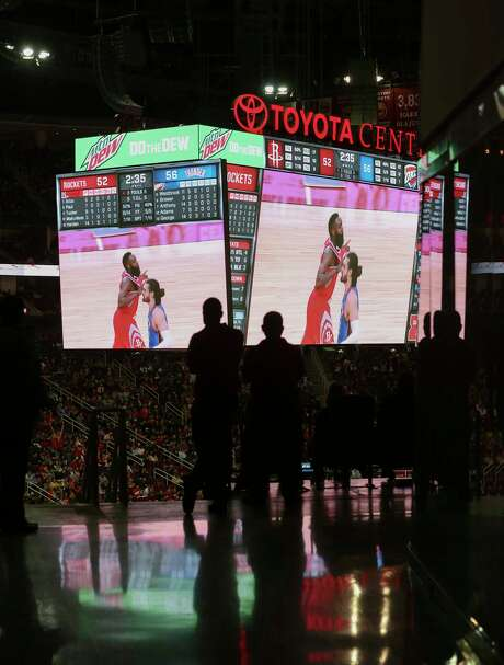 Rockets fans watch the game on the 100-level concourse during the second half. Photo: Yi-Chin Lee / © 2018 Houston Chronicle