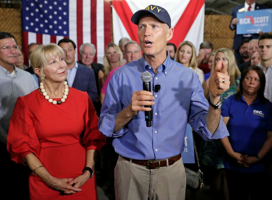 Florida GOP Gov. Rick Scott, with his wife, Ann, announces his campaign for the U.S. Senate at a news conference in Orlando. He is running against incumbent Sen. Bill Nelson, a Democrat. Photo: John Raoux / Associated Press