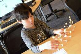 Ian Lanning, 8, of New Canaan, concentrates on building at the Drop-In Marshmallow Challenge at the New Canaan Library, Saturday, April 7, 2018, in New Canaan, Conn.