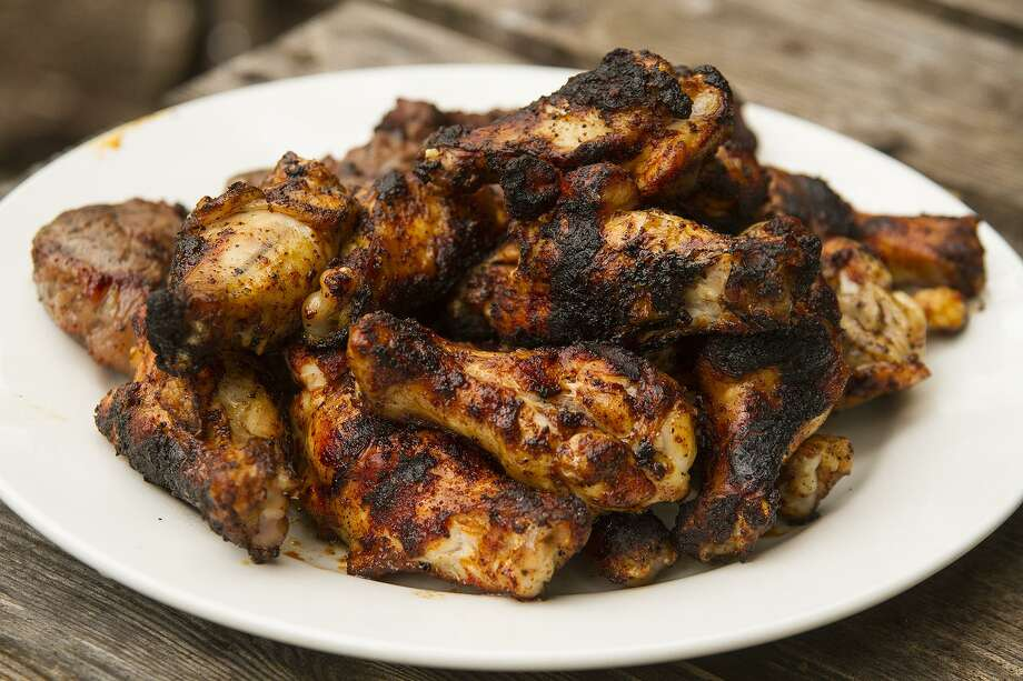 Berbere spiced chicken wings hot off the grill. Photo: Alma E. Hernandez /For The Express-News