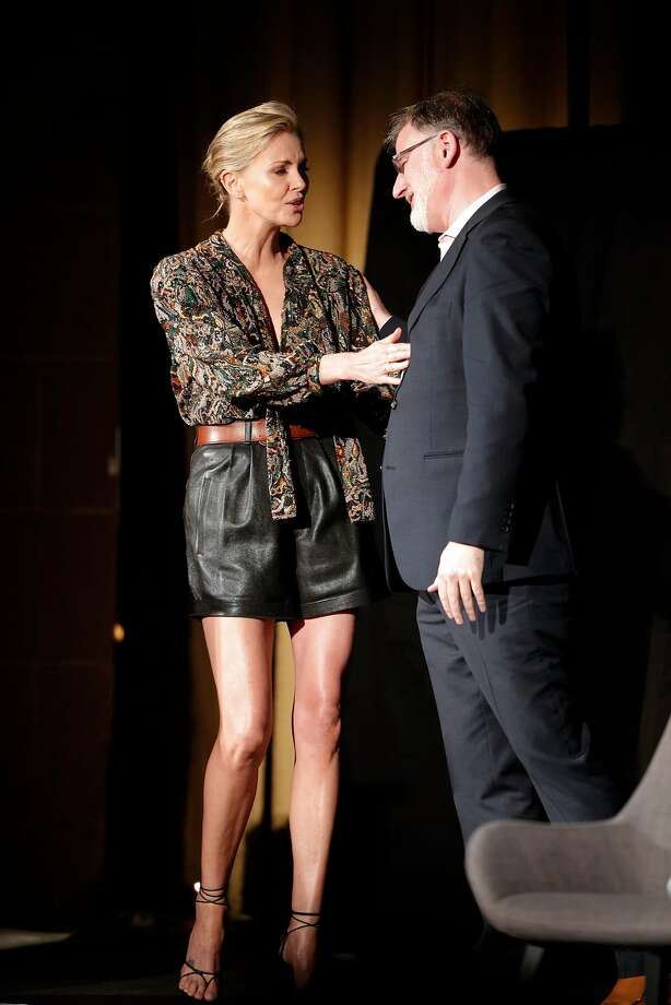 SFFilm Executive Director Noah Cowan greets Charlize Theron at the Castro before her on-stage conversation, part of the tribute to her at the San Francisco Film Festival. Photo: Carlos Avila Gonzalez / The Chronicle