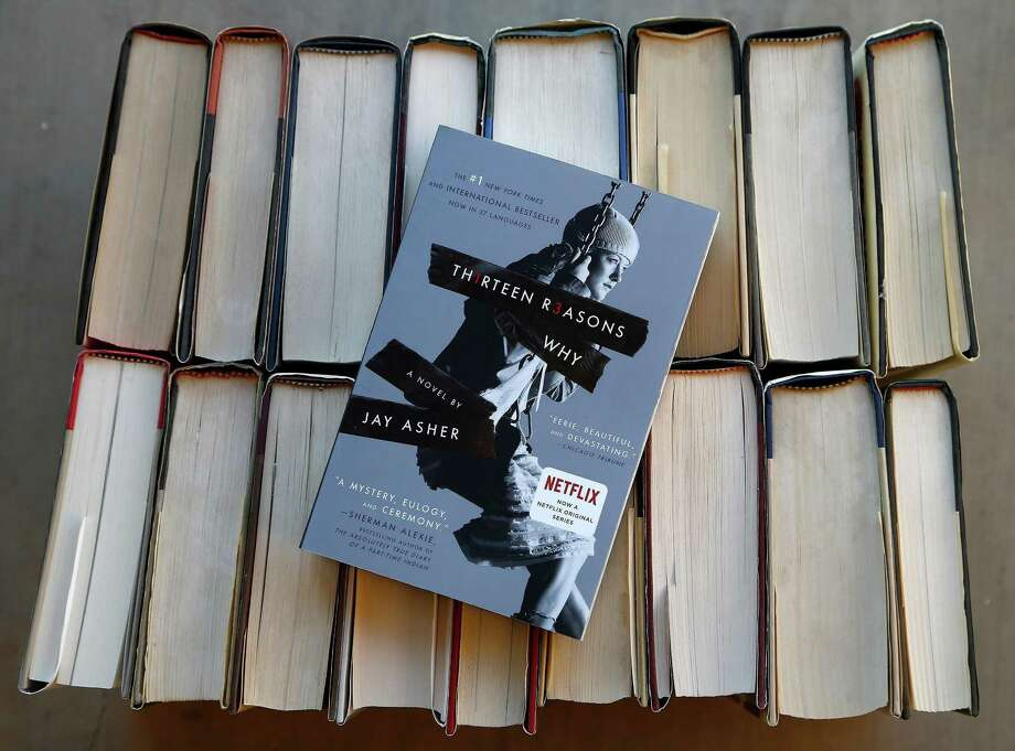 "Jay Asher's ""Thirteen Reasons Why"" and Sherman Alexie's ""The Absolutely True Diary of a Part-Time Indian"" top the American Library Association's list of ""challenged"" books from 2017, those most objected to by parents and other community members. Photo: Ross D. Franklin /Associated Press / Copyright 2017 The Associated Press. All rights reserved."