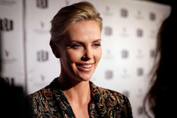 Actress Charlize Theron speaks to reporters on the red carpet before a tribut to her work as part of the San Francisco Film Festival at the Castro Theater in San Francisco., Calif., on Sunday, April 8, 2018.  The tribute followed the showing of the film Tully directed by Jason Reitman