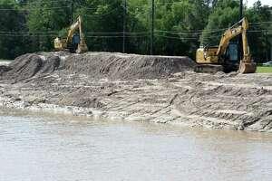 Desilting effort along the Willow Fork Branch of Buffalo Bayou near the Mason Road Bridge in Katy on Wednesday, April 4, 2018.