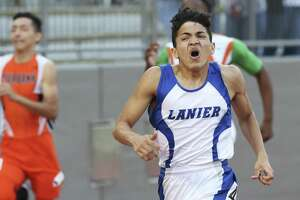 Jesse Hernandez strains near the finish line but wins the 400 meter race for Lanier during District 28-5A track and field meet at Alamo Stadium on April 5, 2018.