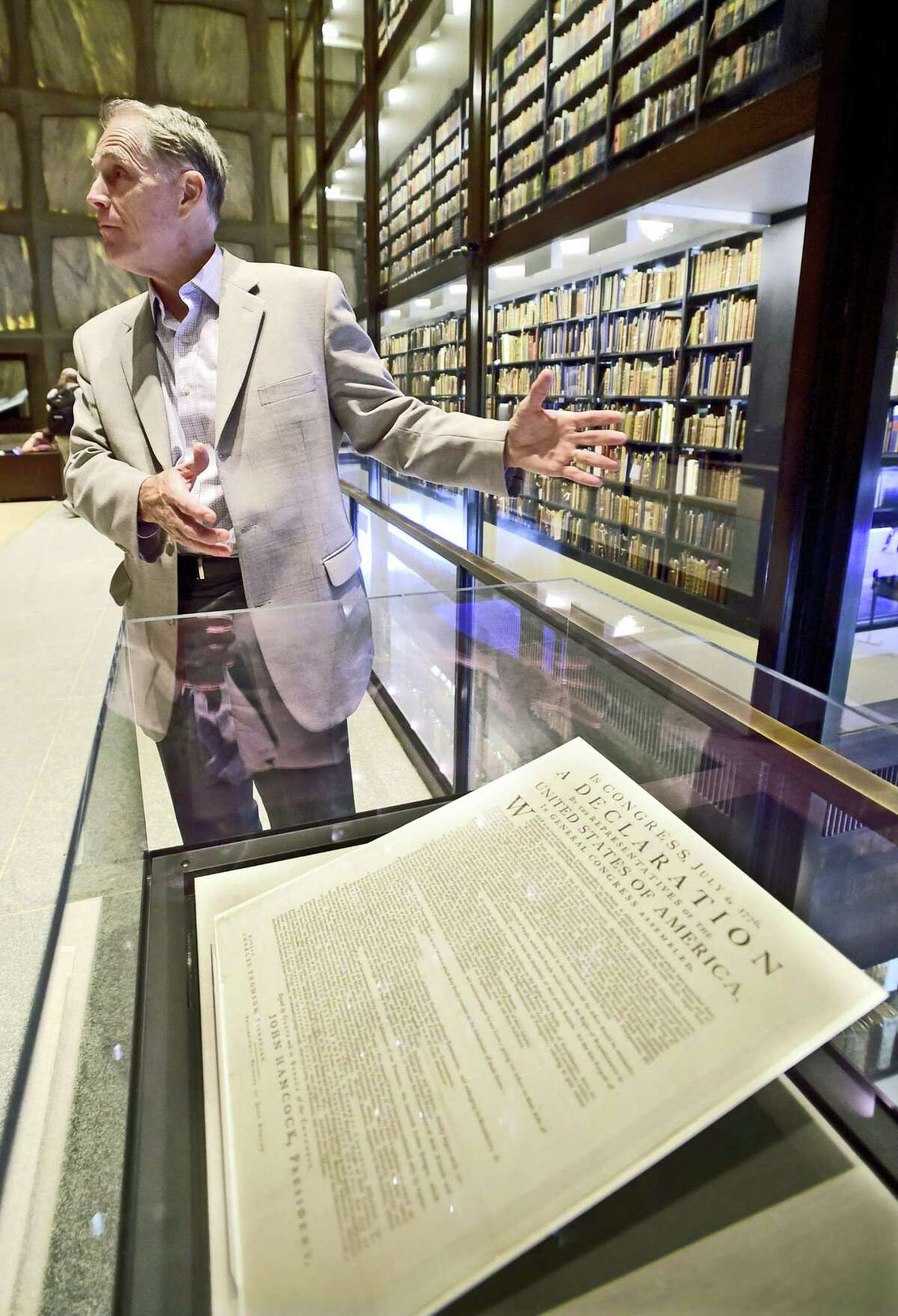 (Peter Hvizdak / Hearst Connecticut Media) New Haven, Connecticut: June 28, 2017. George Miles, the William Robertson Coe Curator of Yale Collections of Western Americana at the Beinecke Rare Book & Manuscript Library at Yale University in New Haven with a first printed issue of the Declaration of Independence by John Dunlap in Philadelphia on July 4, 1776 at the library.