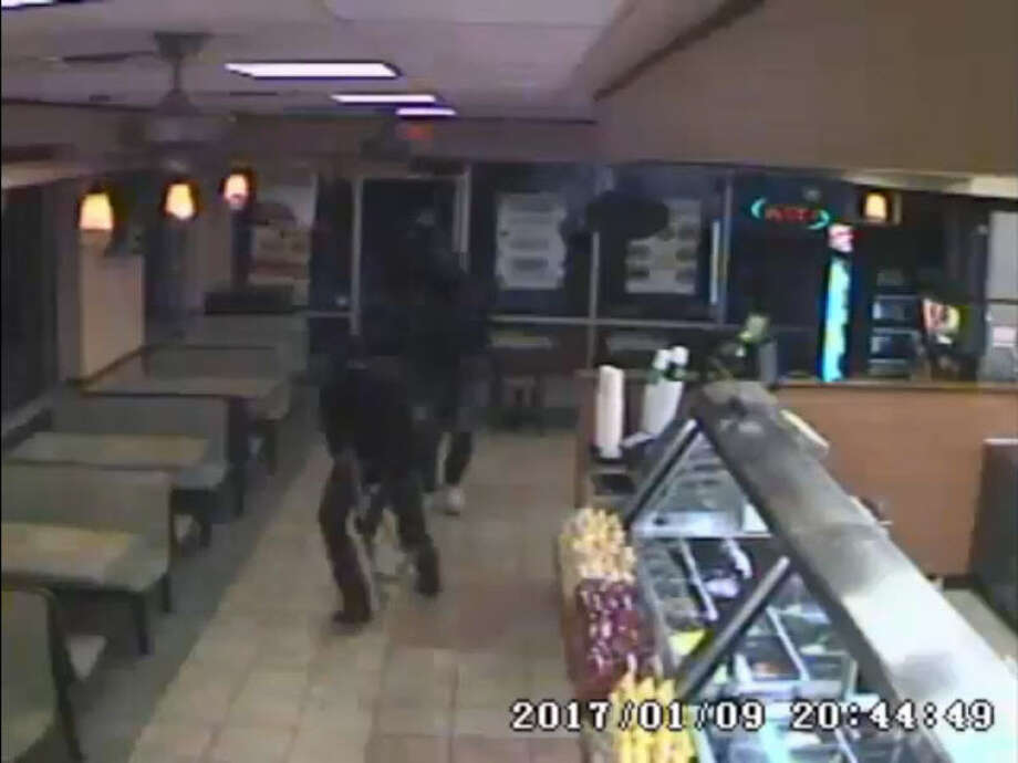 Video captured three armed men pointing firearms at a Subway worker in the 200 block of Gessner and demanding money from the cash register on Jan. 9, 2018, the Houston Police Department says. Anyone with knowledge of their whereabouts can call Crime Stoppers at 713-222-8477. Photo: Houston Police Department