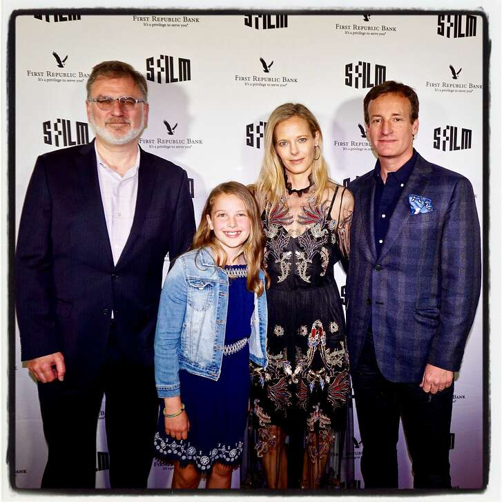 SFFilm honcho Noah Cowan (left) with Daisy Traina and her parents, Katie and Todd Traina at the Castro Theater. April 5, 2018.