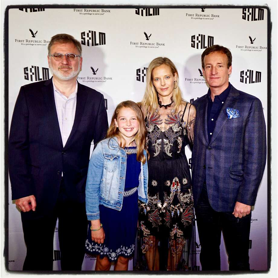 SFILM's Noah Cowan (left), Daisy Traina and her parents, Katie and Todd Traina, at the Castro Theatre on April 5. Photo: Catherine Bigelow / Special To The Chronicle