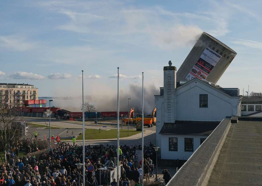 Spectators watch a silo demolition go wrong at Vordingborg Harbor, Denmark, on April 6, 2018. Photo: PER RASMUSSEN/AFP/Getty Images