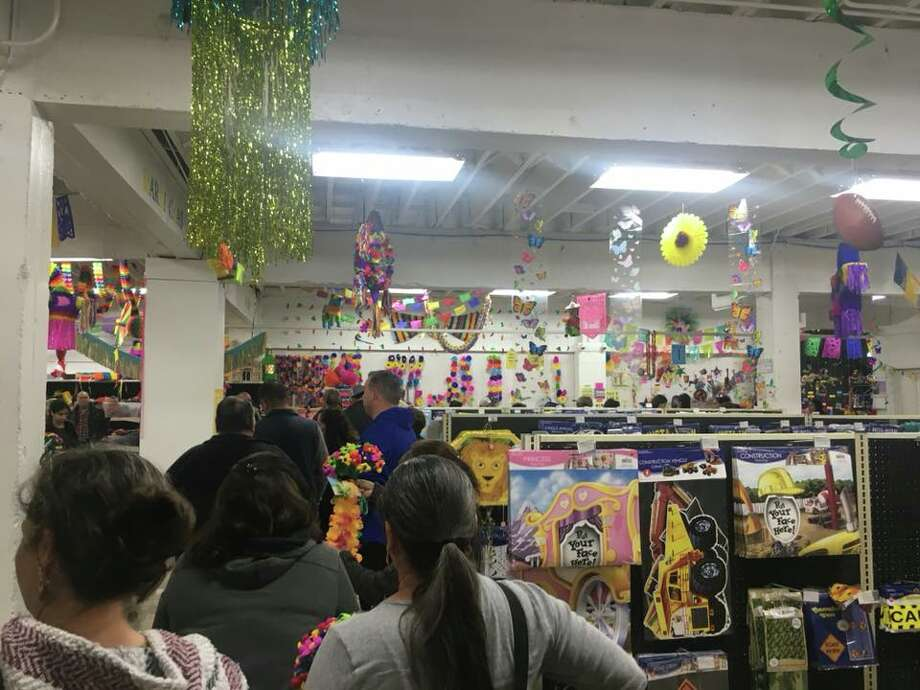 The rush to stock up on decorations for San Antonio's biggest party is a tradition throughout the city and Amols' has been the headquarters for generations. But this year, Fiesta revelers are not lurking for one of 10 parking spaces or cramming into the previous South Flores location. Photo: Madalyn Mendoza