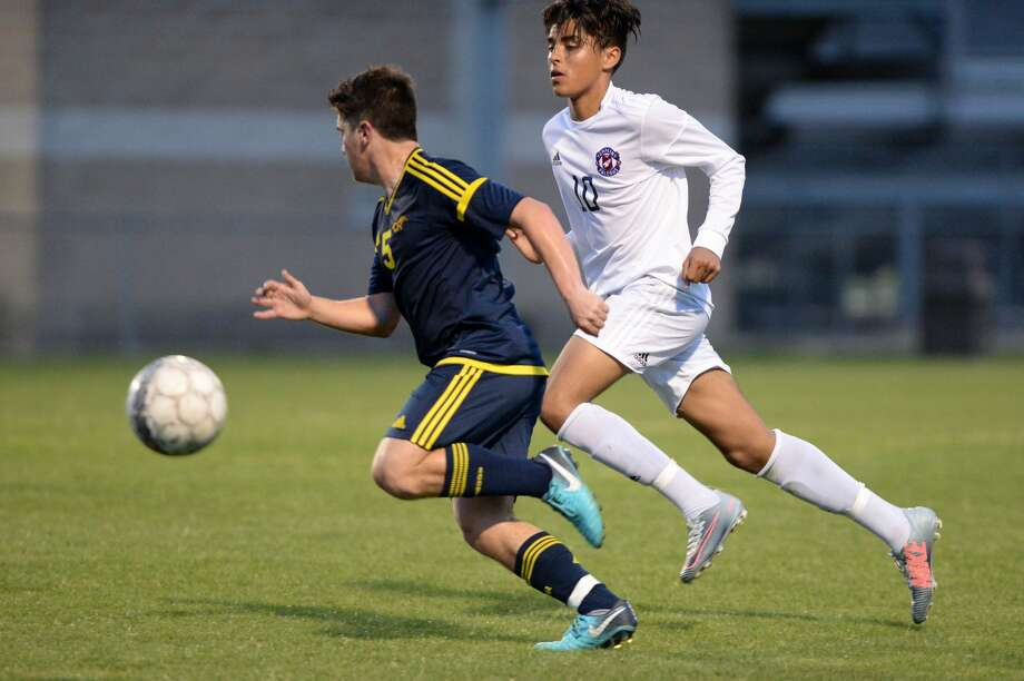Reis Fredrickson (5) of CyRanch and Jovan Prado (10) of Tompkins chase after a ball during the first half of a 6A-III regional quarterfinal soccer playoff between the Tompkins Falcons and the Cy Ranch Mustangs on Friday, April 6, 2018 at Tomball Memorial HS, Tomball, TX. Photo: Craig Moseley/Houston Chronicle