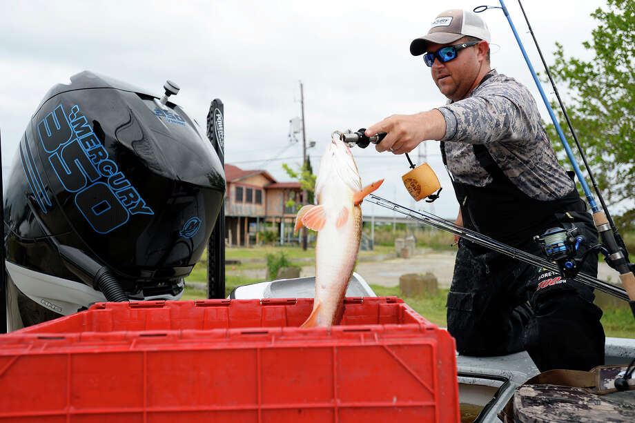Jeremy Reeves, of Orangefield,  gets his fish out of the live well for measuring during the Elite Redfish Series in Port Arthur. The tournament gave competitors a map of which areas they were not allowed to fish in Louisiana.  Photo taken Thursday 4/5/18 Ryan Pelham/The Enterprise Photo: Ryan Pelham / ©2017 The Beaumont Enterprise/Ryan Pelham