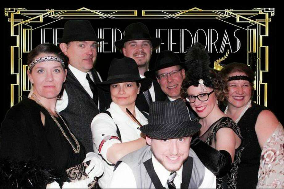Some of the170 supporterspose for a photo during thesecond annual Feathers and Fedoras fundraiser for Disability Network of Mid-Michigan. (Photo provided)