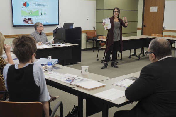 Becca Myers, data manager with Educate Midland, speaks April 4 during a meeting with Early Childhood Action Network members.