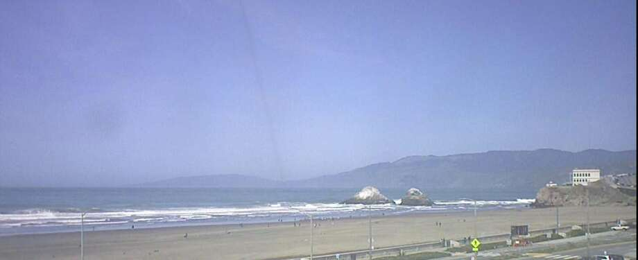 A live webcam from OceanBeach.org captures sunny conditions at S.F.'s most beloved beach for surfers, dog walkers and sun worshippers on April 9, 2018. Photo: OceanBeach.org Webcam