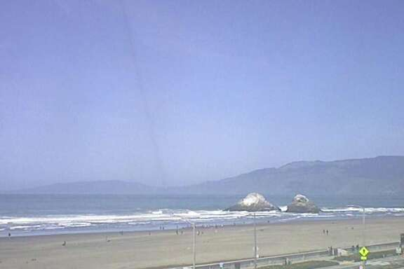 A live webcam from OceanBeach.org captures sunny conditions at S.F.'s most beloved beach for surfers, dog walkers and sun worshippers on April 9, 2018.