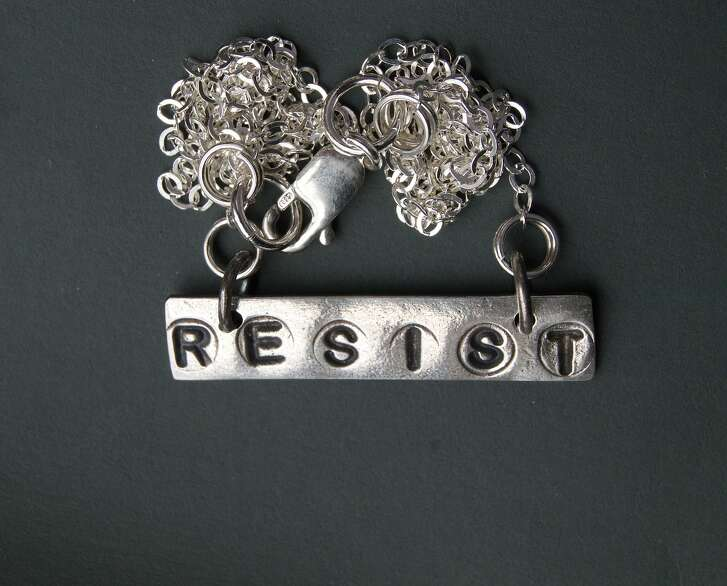 Inspired by the signs Lynn Cobb saw at the 2017 Women�s March, the Vallejo silversmith created a �Speak Out� series by stamping �Resist� and a few other slogans on small silver pendants that she sells on Etsy and her ow site, www.lynncobb.com