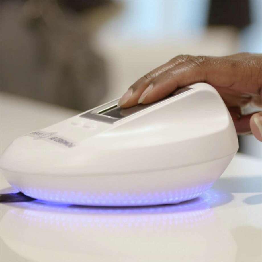 Delta fingerprint scanner. Photo: Delta Air Lines /TNS / Atlanta Journal-Constitution