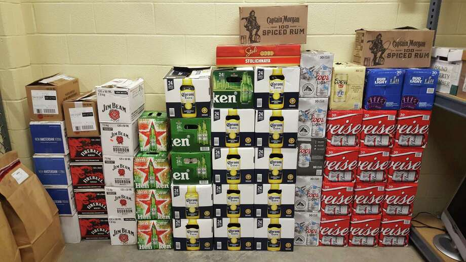Beer and alcohol that police recently seized from a Danbury apartment where the products were purportedly being sold illegally. Photo: / Contributed