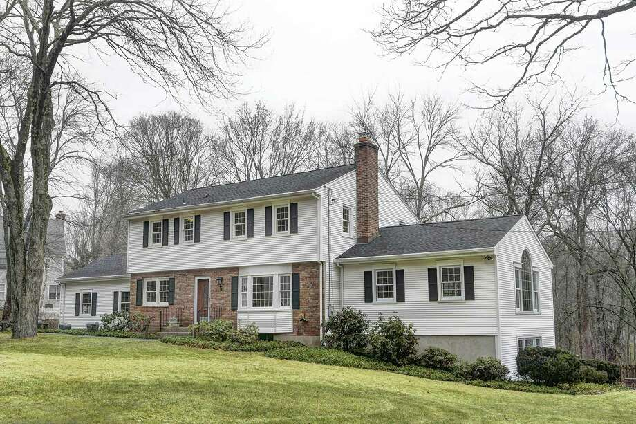 A Garrison colonial house sits on a half of an acre property in a quiet neighborhood at 59 Rural Drive.