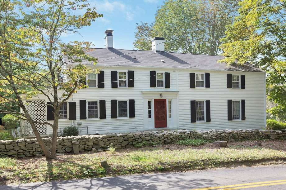 The updated antique colonial house at 25 Fanton Hill Road has nine rooms and 3,674 square feet of living space.