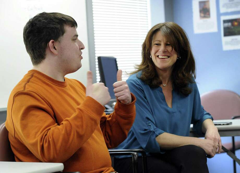 Chris Fitzpatrick, 22, left, gives a thumbs up sign, talking with Karen Samperi, a program manager with Ability Beyond, in Danbury Thursday, April 5, 2018. Chris is a client of Ability Beyond. Photo: Carol Kaliff / Hearst Connecticut Media / The News-Times