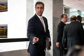 FILE -- Michael Cohen, President Donald Trump�s longtime personal lawyer, speaks to reporters after a closed-door meeting with the Senate Intelligence Committee in Washington on Sept. 19, 2017. The FBI raided Cohen's office on Monday, April 9, 2018, seizing records related to several topics including payments to a pornographic-film actress. (Al Drago/The New York Times)