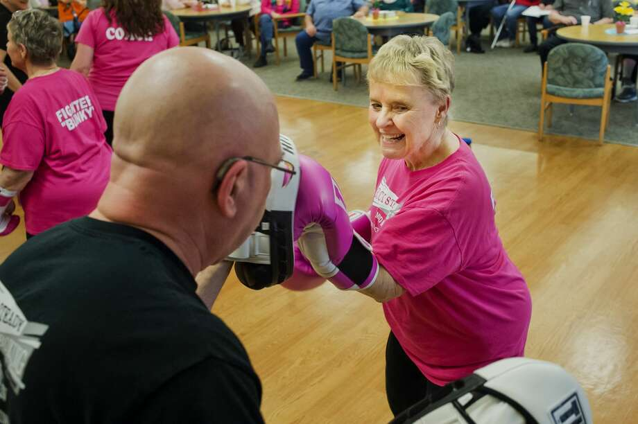 Elaine Embrey of Bay City spars with Neal White of Midland during a presentation by Rock Steady Boxing for the Midland Parkinson's Support Group on Monday, April 9, 2018 at Senior Services of Midland County. Rock Steady Boxing, located at 1914 S. Saginaw Rd., provides boxing classes that have been shown to reduce the impact of Parkinson's. (Katy Kildee/kkildee@mdn.net) Photo: (Katy Kildee/kkildee@mdn.net)