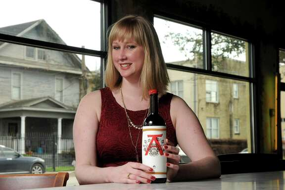 Adele Corrigan with a bottle of 2016 Villa Venti at 13 Celsius