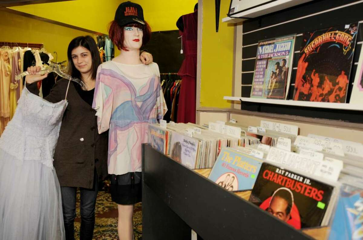 Brittany Nasser, with some of the vintage clothing available in her shop. (Luanne M. Ferris/Times Union)