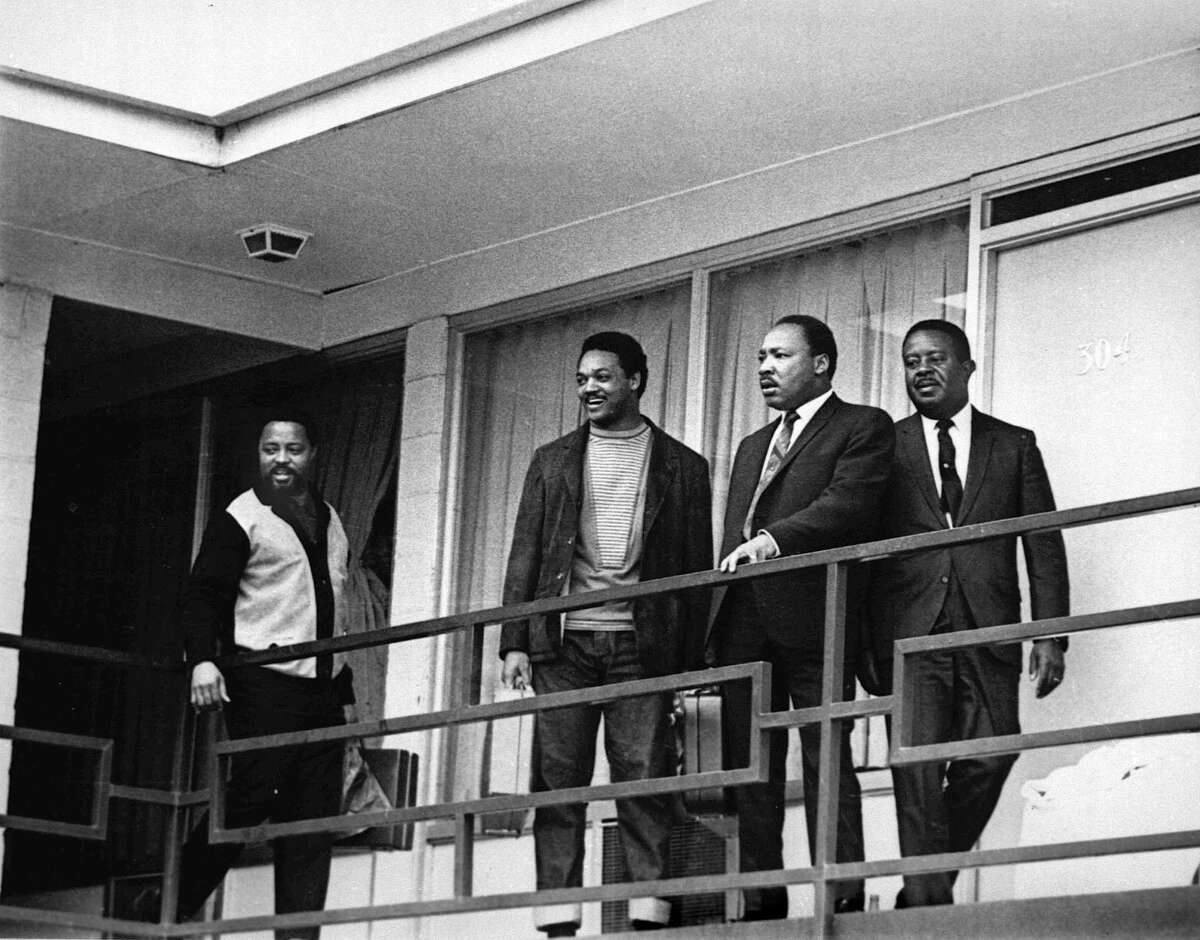 The Rev. Martin Luther King Jr. stands with other civil rights leaders on the balcony of the Lorraine Motel in Memphis, Tenn., a day before he was assassinated at approximately the same place. From left are Hosea Williams, Jesse Jackson, King, and Ralph Abernathy.