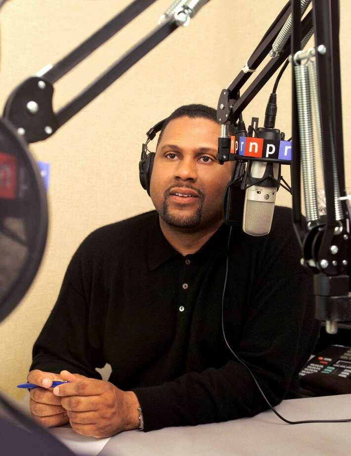 Journalist and commentator Tavis Smiley broadcasts his show for National Public Radio from his Los Angeles studio in April 2002. He is making a comeback after his dismissal from NPR — a dismissal that has sparked a lawsuit. Photo: KEVIN FOLEY /AP / NPR