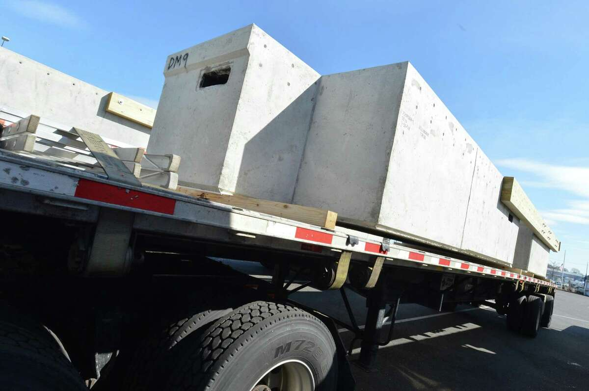 A section of the new docks arrives on a tractor trailer at Veterans Memorial Park on Monday April 9, 2018 in Norwalk Conn. Six 18-wheeler flatbed trucks arrived at docks on Monday, each carrying massive plastic foam-filled concrete sections that will form the new visitors' docks at the public boat-lunch. The docks arrived from Bellingham Marine's plant in York, Pa., and will be installed by Terry Construction over the next several weeks.