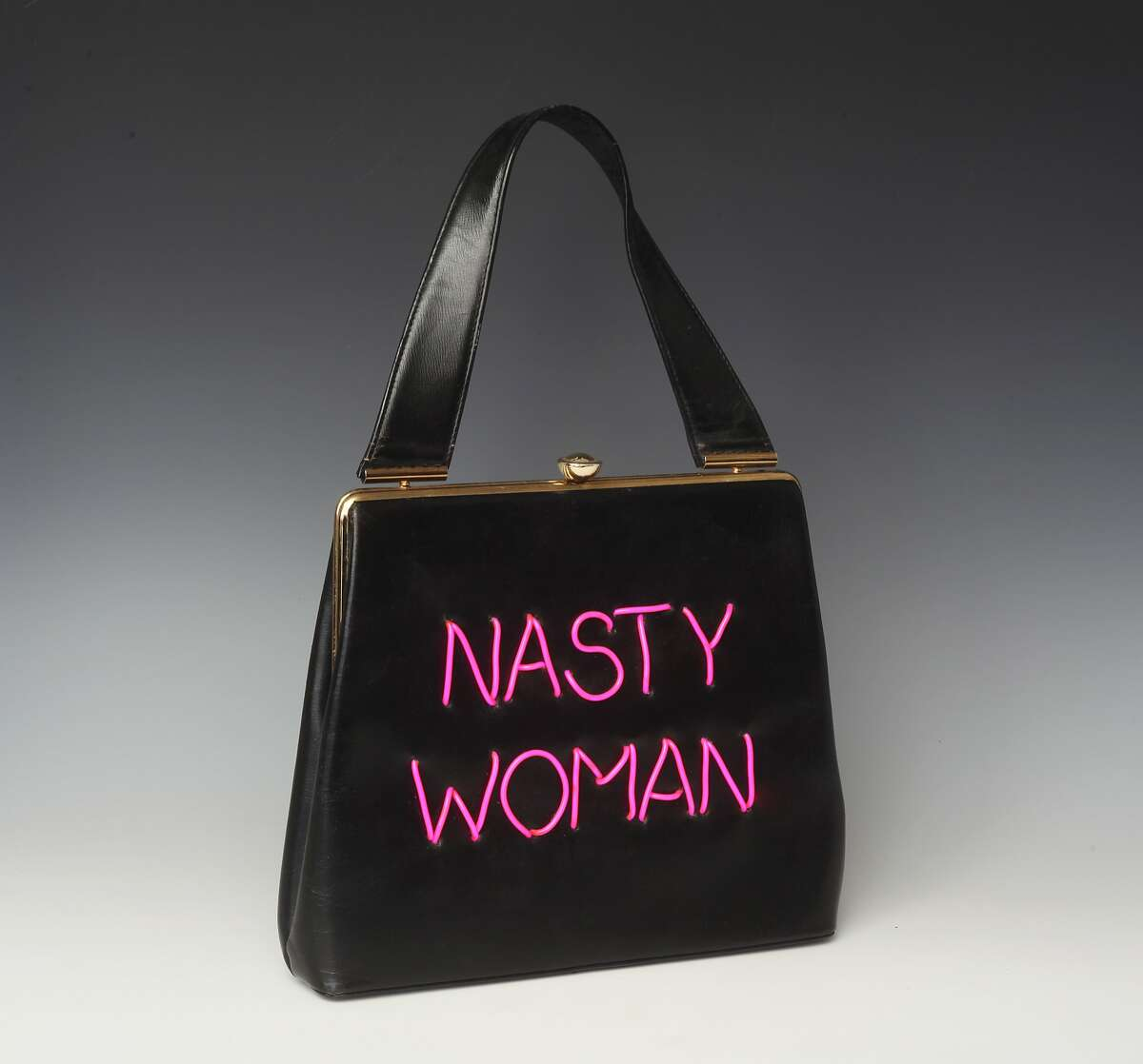 Michele Pred, a Berkeley artist, is making political statements with her Power of the Purse, a series of vintage handbags that incorporate meaningful, timely political messages. �Nasty Woman,� �Me Too,� and �My Body, My Business� are some of the phrases created using electroluminescent wire that are sewed on the purses. The series is limited edition, with only 10 made with each message.