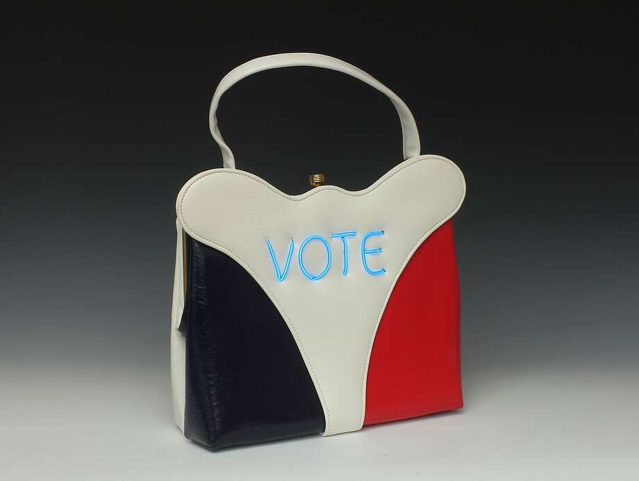 Michele Pred, a Berkeley artist, is making political statements with her Power of the Purse, a series of vintage handbags that incorporate meaningful, timely political messages. Nasty Woman, Me Too, and My Body, My Business are some of the phrases created using electroluminescent wire that are sewn on the purses. The series is limited edition, with only 10 made with each message. Photo: Don Felton