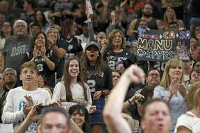 San Antonio Spurs fans cheer during first half action against the Houston Rockets Sunday April 1, 2018 at the AT&T Center.