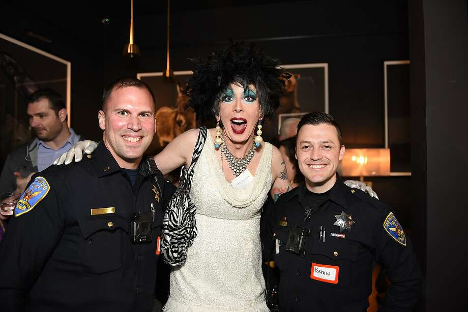 San Francisco Police Department Lt. Christopher Del Gandio, emcee Lucky Penny and Officer Bryan Santana of the SFPD Mission Station attend a celebration for the Rotary Club of San Francisco, Castro. Photo: Steven Underhill / Special To The Chronicle