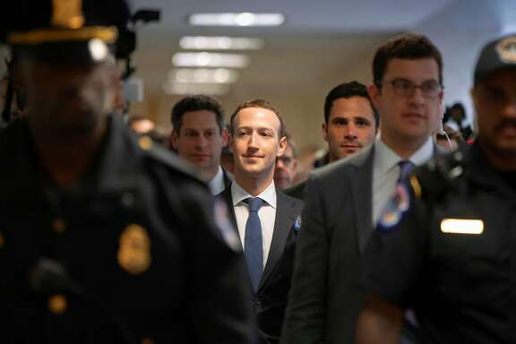 Facebook CEO Mark Zuckerberg arrives on Capitol Hill in Washington, Monday, April 9, 2018. Zuckerberg testified Tuesday before a joint hearing of the Commerce and Judiciary Committees about the use of Facebook data to target American voters in the 2016 election. (AP Photo/J. Scott Applewhite)