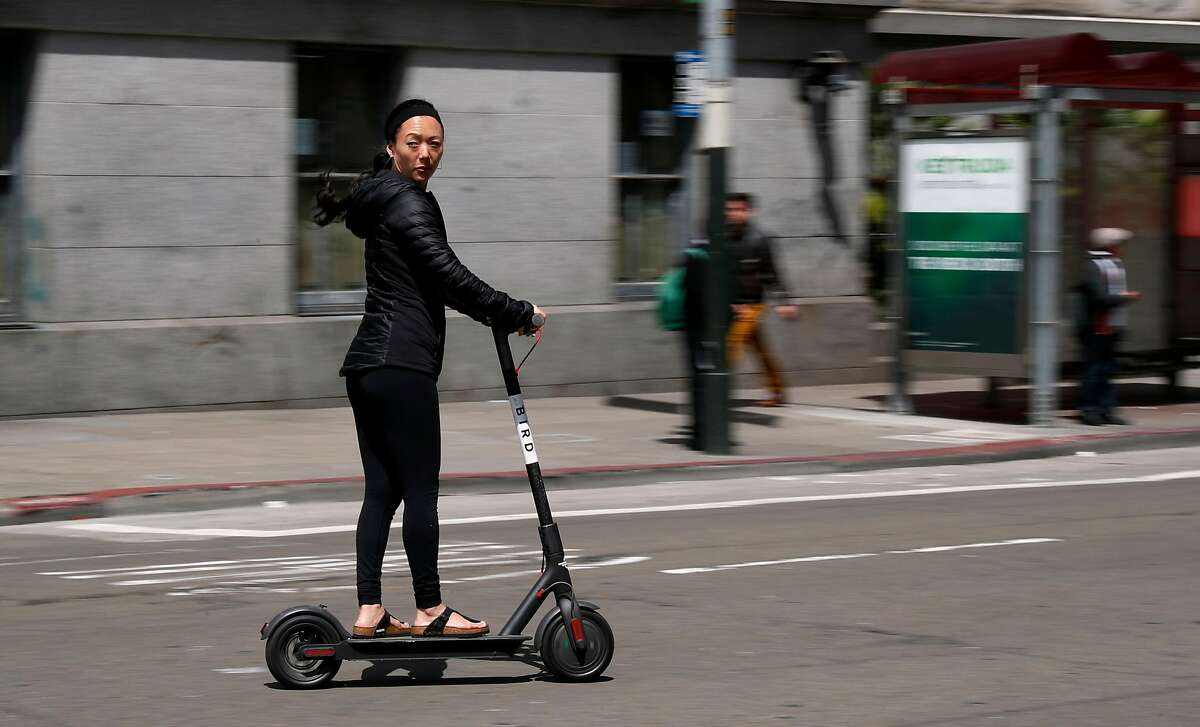 Cruising down Mission st. on a Bird scooter as seen on Mon. April 9, 2018, in San Francisco.