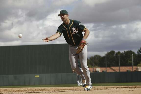Matt Olson #28 of the Oakland Athletics goes through infield drills during a spring training workout at Fitch Park on February 19, 2018 in Mesa, Arizona.