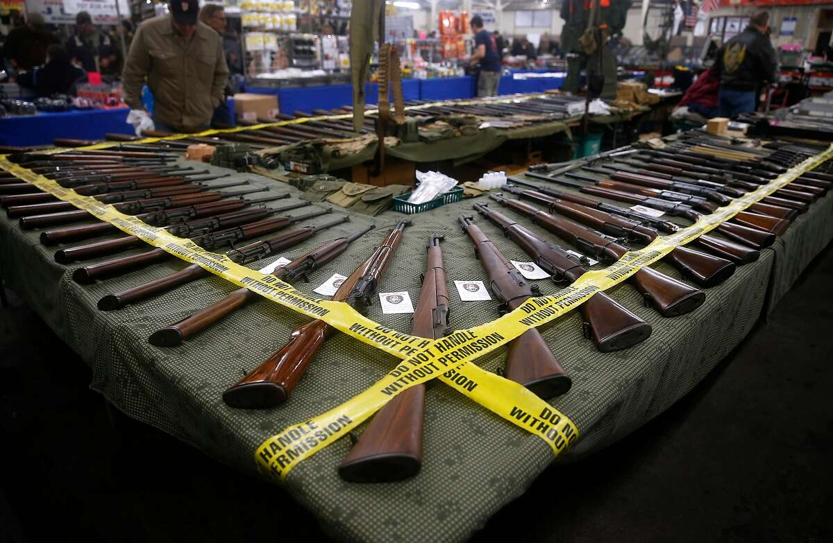 Rifles are displayed by a vendor at the Crossroads of the West gun show at the Cow Palace in 2016.