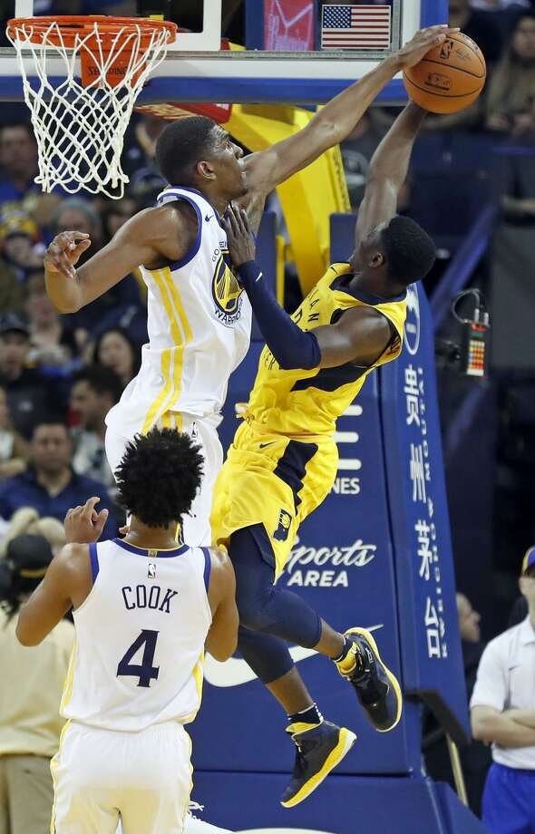 Kevon Looney blocks a shot by the Pacers' Darren Collison. Looney averaged 1.5 blocks per game in 21.1 minutes in March. Photo: Scott Strazzante / The Chronicle / San Francisco Chronicle