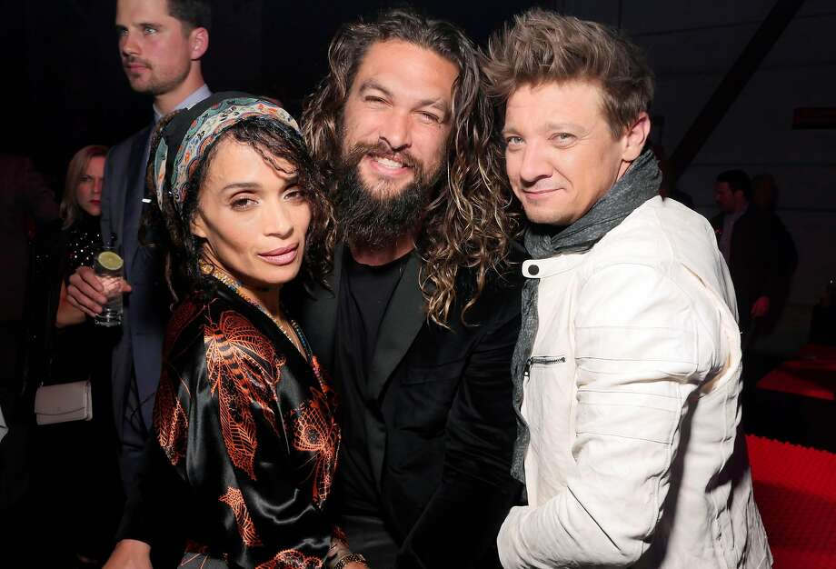 Cartier's Bold and Fearless party drew a wealth of film, fashion and music talent to Pier 49 on April 6 for the launch of the Santos watch. Pictured, left to right: Lisa Bonet, Jason Momoa and Jeremy Renner. Photo: Stéphane Feugère